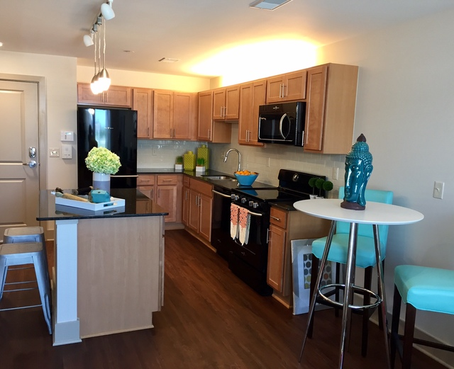 Orleans Landing - Kitchen with hard wood floors and granite countertops
